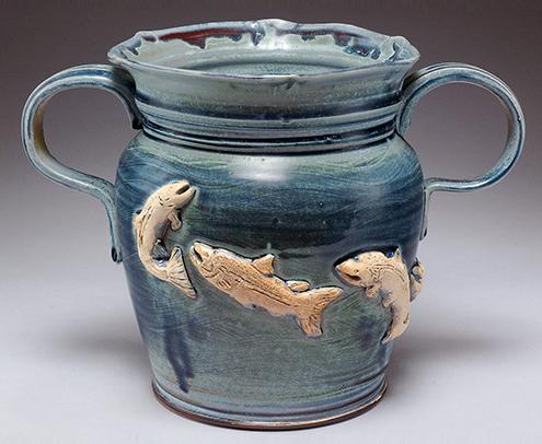 Ceramic mug with fish jumping on it