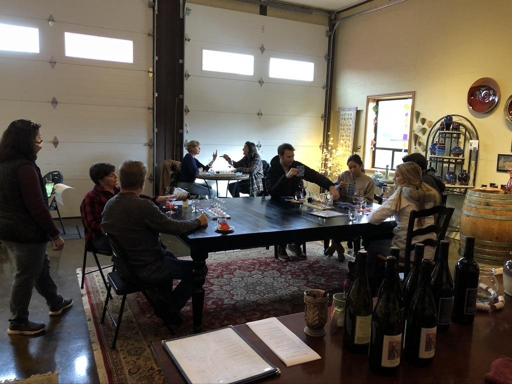 Groups tasting wine in tasting room