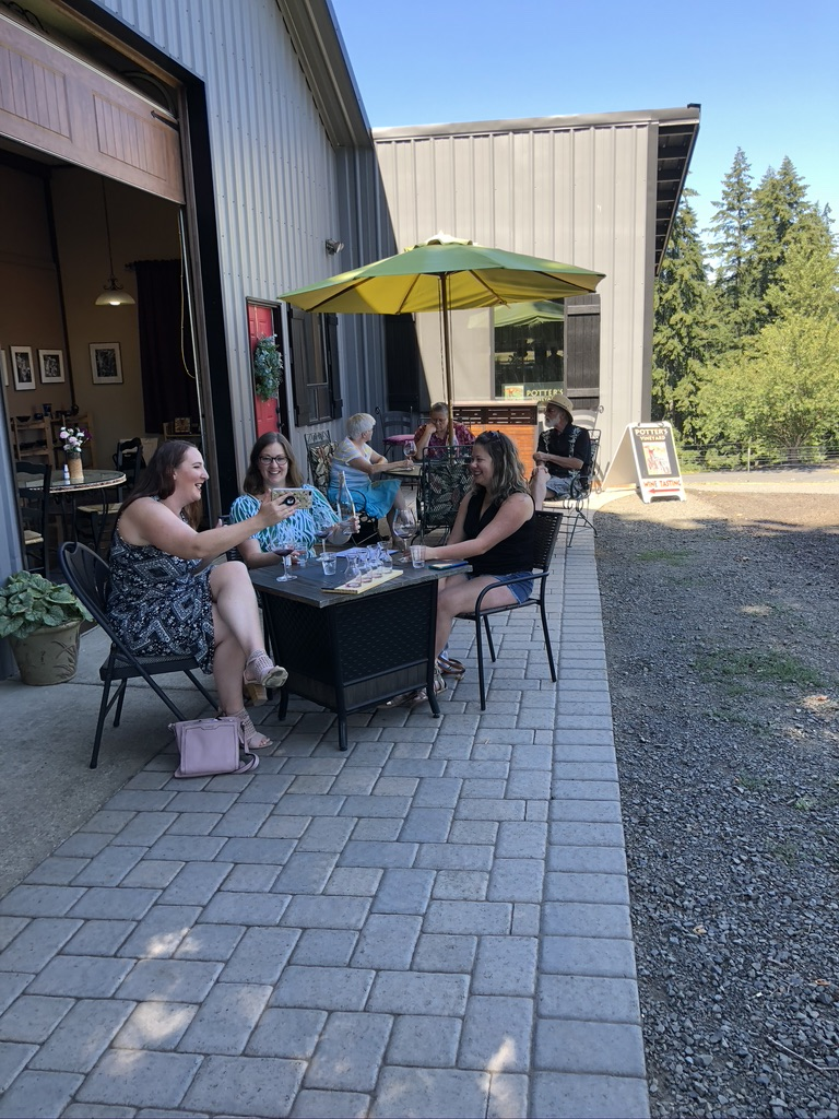 Groups tasting wine outside
