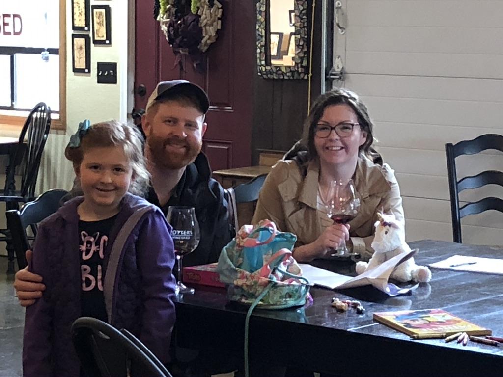 Family enjoying a seated tasting