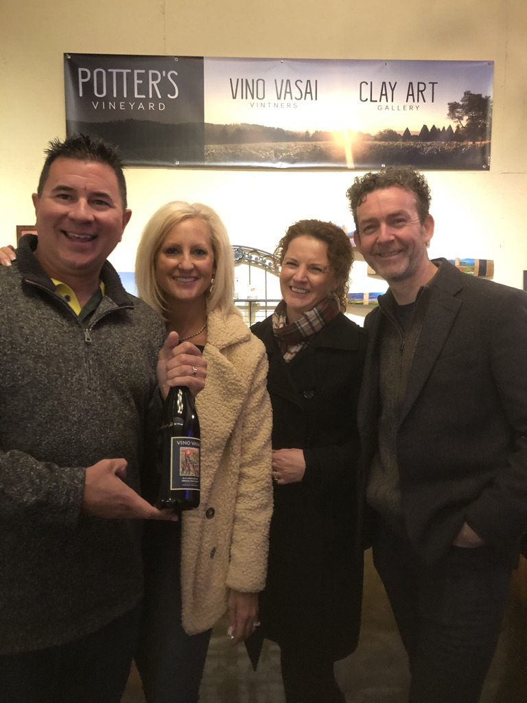 Guests smiling with bottle
