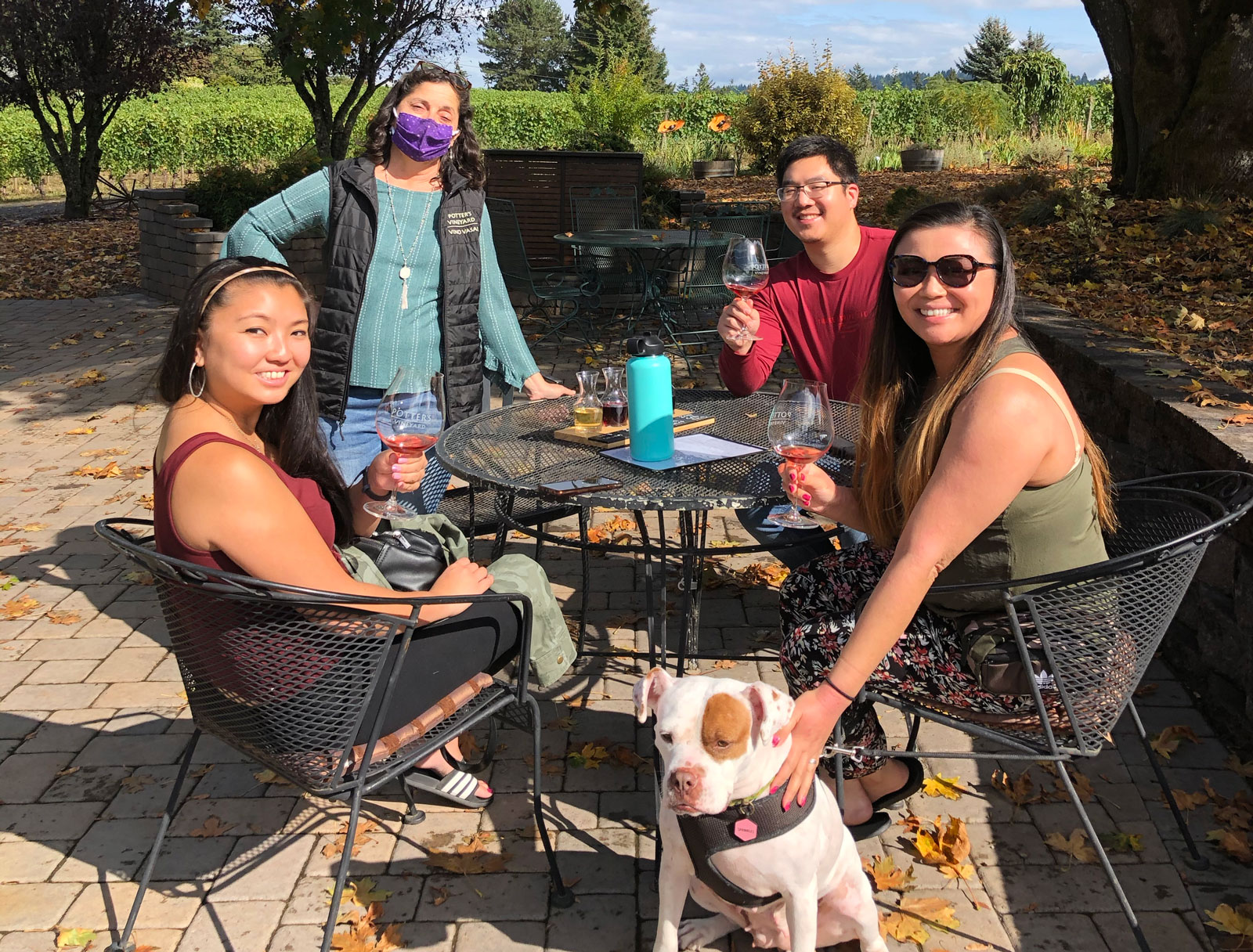 Guests tasting on the patio with their dog